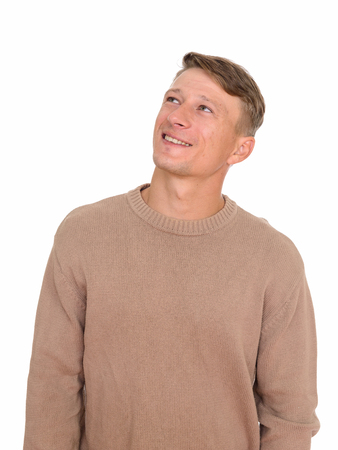 Studio shot of young happy Caucasian man thinking isolated again
