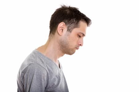 Ver perfil de triste joven mirando hacia abajo Foto de archivo