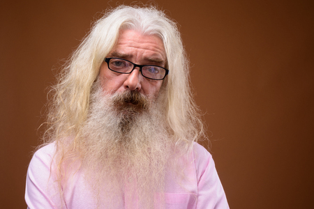 Portrait of senior bearded man wearing pink shirt Stock fotó