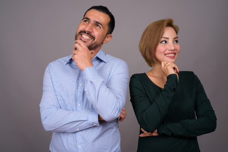 Multi-ethnic couple in love against gray background Banco de Imagens - 124590120