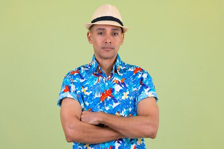 Handsome multi ethnic tourist man with arms crossed