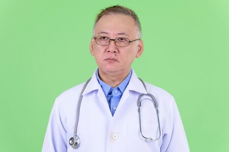 Face of mature Japanese man doctor thinking