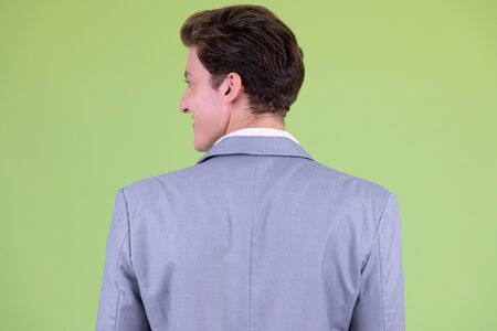 Closeup rear view of young handsome businessman