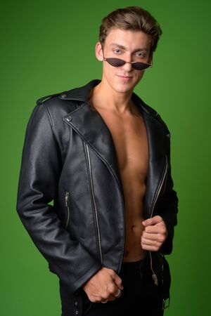 Young handsome rebellious man wearing leather jacket Stock Photo