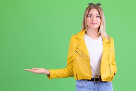 Portrait of young rebellious blonde woman showing something Stock Photo