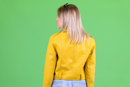 Rear view of young rebellious blonde woman looking over shoulder Stok Fotoğraf