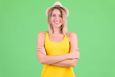 Happy young beautiful blonde tourist woman smiling with arms crossed Stock fotó