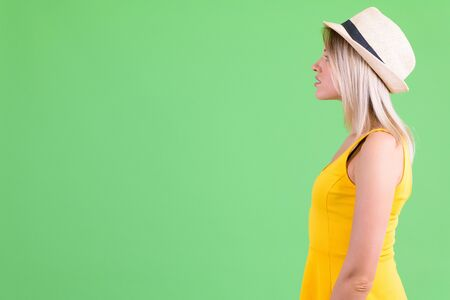 Profile view of young beautiful blonde tourist woman