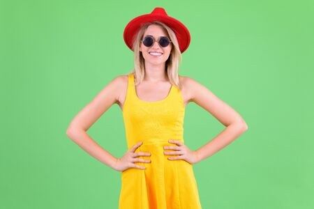 Happy young beautiful blonde tourist woman wearing red hat Stok Fotoğraf