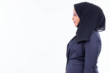 Profile view of young beautiful African Muslim businesswoman