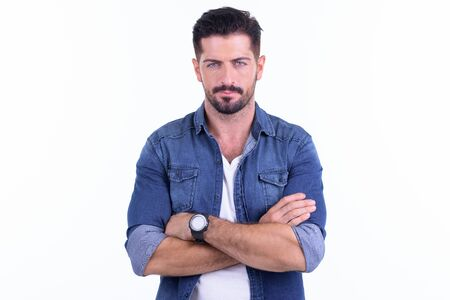 Young handsome bearded hipster man with arms crossed Stock Photo
