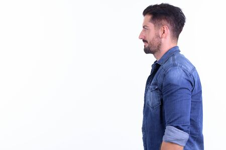 Profile view of young handsome bearded hipster man