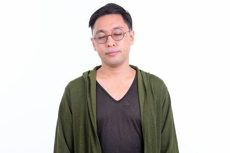 Japanese man wearing eyeglasses relaxing with eyes closed