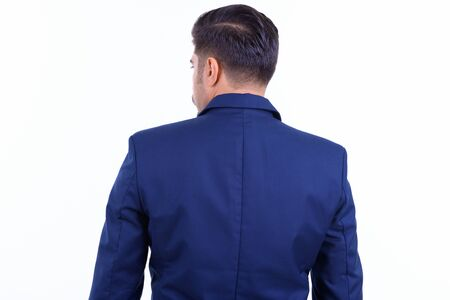 Rear view of bearded Persian businessman looking over shoulder