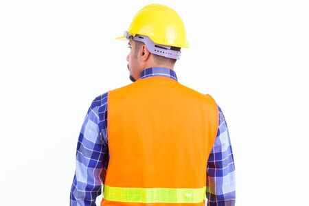 Rear view of bearded Persian man construction worker