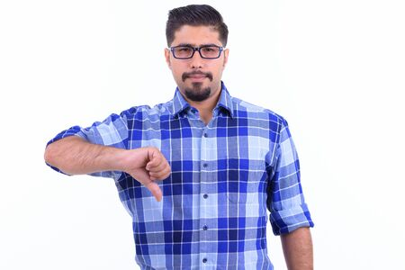 Stressed bearded Persian hipster man giving thumbs down 写真素材 - 129804216