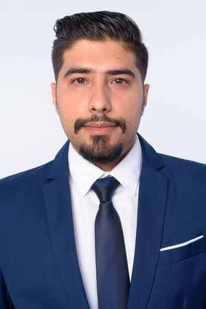 Face of handsome bearded Persian businessman in suit