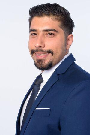 Closeup profile view of happy bearded Persian businessman looking at camera