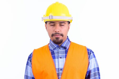 Face of bearded Persian man construction worker relaxing with eyes closed