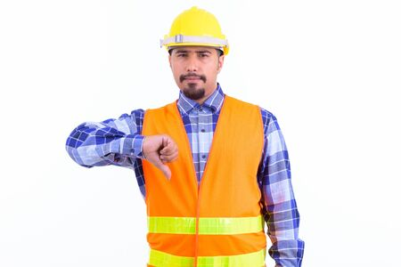 Stressed bearded Persian man construction worker giving thumbs down 写真素材 - 129804462