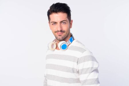 Face of handsome bearded man with headphones