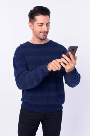 Portrait of handsome bearded man using phone Stock Photo