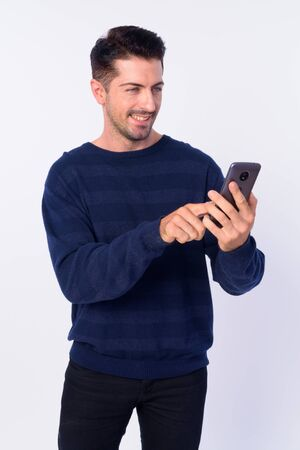 Portrait of happy handsome bearded man using phone Stock Photo