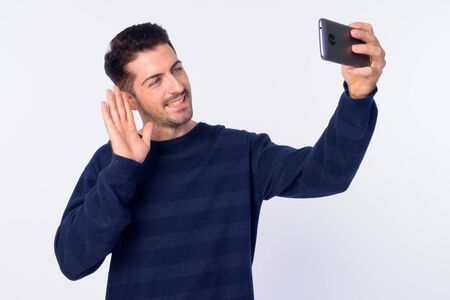 Portrait of happy handsome bearded man vlogging with phone Stock Photo
