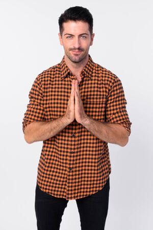 Portrait of handsome bearded hipster man with hands together greeting with respect Stock Photo