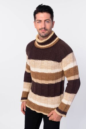 Handsome bearded man wearing turtleneck sweater ready for winter