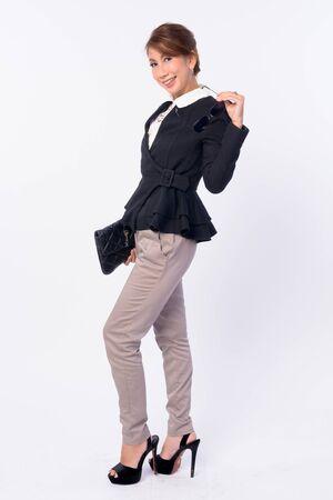 Full body shot of happy mature Asian businesswoman smiling Stockfoto