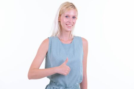 Portrait of happy young beautiful blonde woman giving thumbs up Banco de Imagens