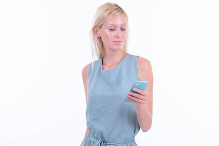 Portrait of young beautiful blonde woman using phone Banco de Imagens