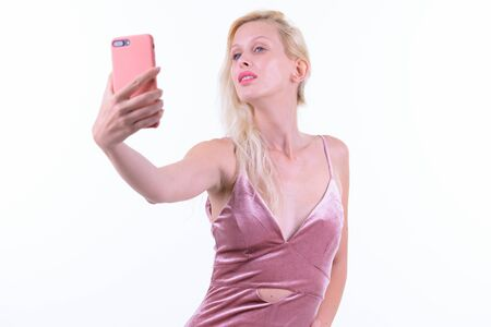 Young beautiful blonde woman taking selfie and ready to party