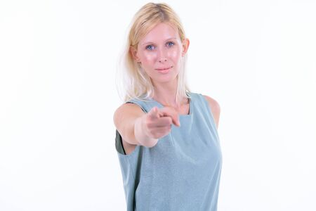 Portrait of young beautiful blonde woman pointing at camera Banco de Imagens