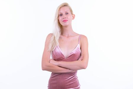Young beautiful blonde woman with arms crossed ready to party