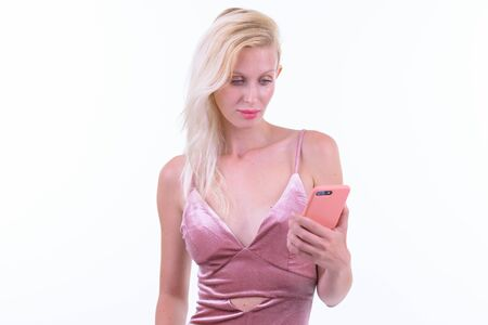 Young beautiful blonde woman using phone ready to party Banco de Imagens