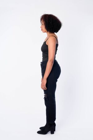 Full body shot profile view of young beautiful African woman