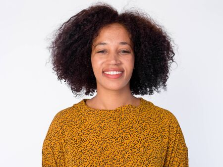 Face of happy young beautiful African woman smiling