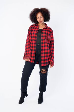 Full body shot of young beautiful African hipster woman Stock Photo