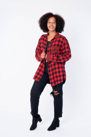 Full body shot of happy young beautiful African hipster woman smiling
