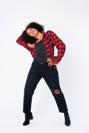 Full body shot of happy young beautiful African hipster woman posing