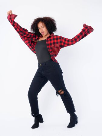 Full body shot of young beautiful African hipster woman posing