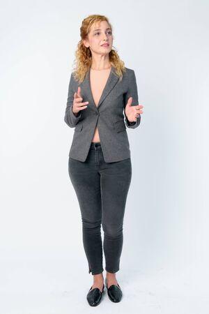 Full body shot of beautiful blonde businesswoman explaining something