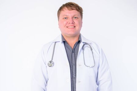 Face of happy overweight man doctor smiling Stock Photo