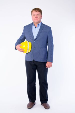 Full body shot of overweight businessman as engineer