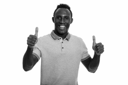 Young happy black African man giving thumbs up