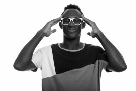 Studio shot of young African man in black and white Stock Photo