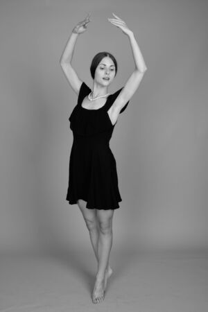 Studio shot of young beautiful woman in black and white