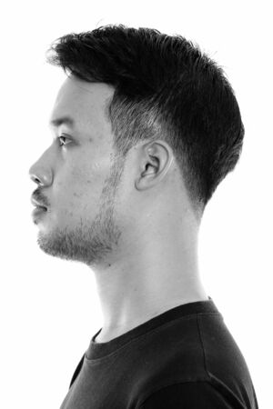 Profile view of face of young Asian man